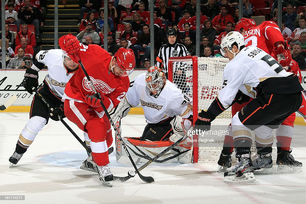 <a gi-track='captionPersonalityLinkClicked' href=/galleries/search?phrase=Tomas+Tatar&family=editorial&specificpeople=5652303 ng-click='$event.stopPropagation()'>Tomas Tatar</a> #21 of the Detroit Red Wings bobbles the puck as <a gi-track='captionPersonalityLinkClicked' href=/galleries/search?phrase=Luca+Sbisa&family=editorial&specificpeople=4893043 ng-click='$event.stopPropagation()'>Luca Sbisa</a> #5, <a gi-track='captionPersonalityLinkClicked' href=/galleries/search?phrase=Toni+Lydman&family=editorial&specificpeople=204145 ng-click='$event.stopPropagation()'>Toni Lydman</a> #32 and goalie Viktor Fasth #30 of the Anaheim Ducks all close in during a NHL game against the Anaheim Ducks on February 15, 2013 at Joe Louis Arena in Detroit, Michigan.
