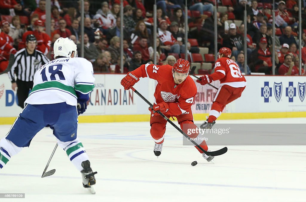 <a gi-track='captionPersonalityLinkClicked' href=/galleries/search?phrase=Tomas+Tatar&family=editorial&specificpeople=5652303 ng-click='$event.stopPropagation()'>Tomas Tatar</a> #21 of the Detroit Red Wings carries the puck across the blue line as <a gi-track='captionPersonalityLinkClicked' href=/galleries/search?phrase=Ryan+Stanton&family=editorial&specificpeople=7184071 ng-click='$event.stopPropagation()'>Ryan Stanton</a> #18 of the Vancouver Canucks defends during the first period of the game at Joe Louis Arena on February 3, 2014 in Detroit, Michigan. The Red Wings defeated the Canucks 2-0.