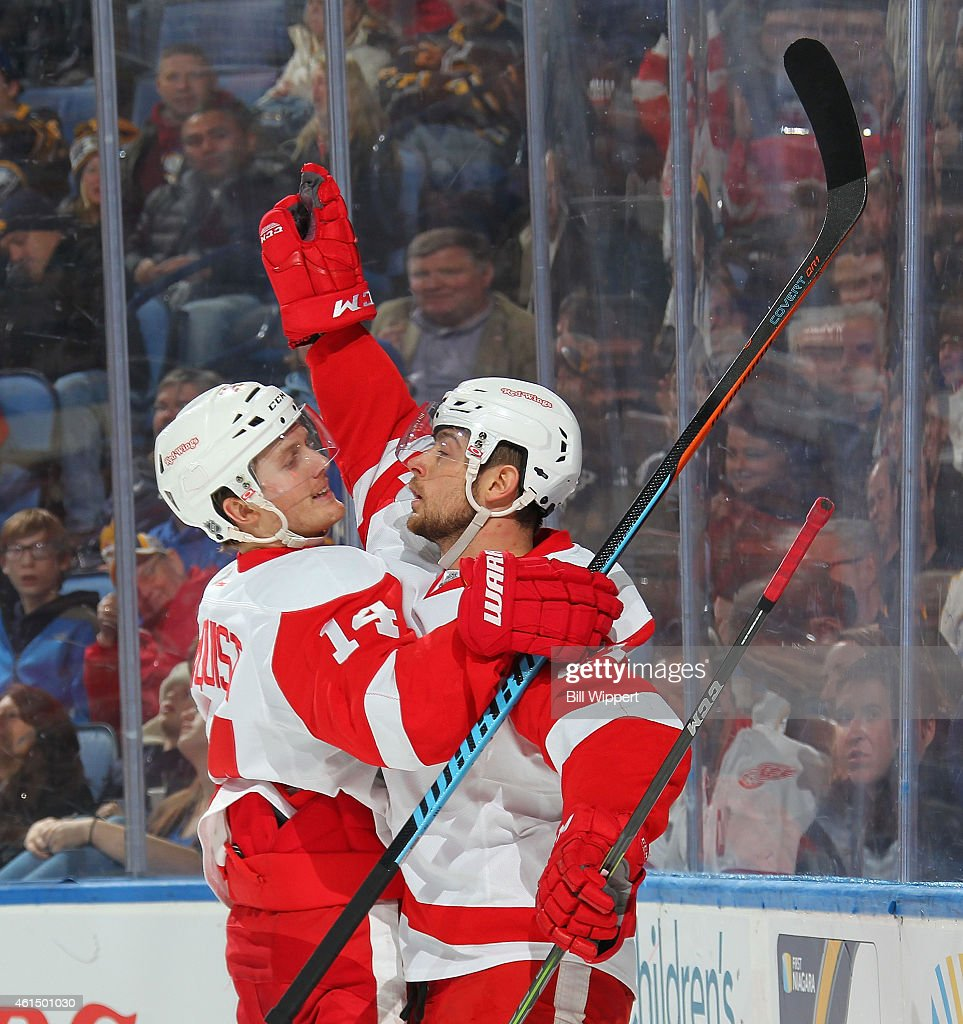 Tomas Tatar of the Detroit Red Wings celebrates his second period goal against the Buffalo Sabres with teammate Gustav Nyquist on January 13 2015 at...