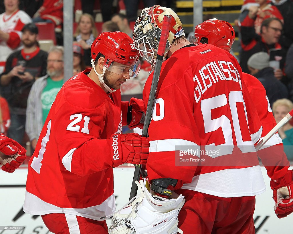 <a gi-track='captionPersonalityLinkClicked' href=/galleries/search?phrase=Tomas+Tatar&family=editorial&specificpeople=5652303 ng-click='$event.stopPropagation()'>Tomas Tatar</a> #21 of the Detroit Red Wings congratulates teammate <a gi-track='captionPersonalityLinkClicked' href=/galleries/search?phrase=Jonas+Gustavsson&family=editorial&specificpeople=886789 ng-click='$event.stopPropagation()'>Jonas Gustavsson</a> #50 after an NHL game against the Tampa Bay Lightning on March 30, 2014 at Joe Louis Arena in Detroit, Michigan. Detroit defeated Tampa Bay 3-2