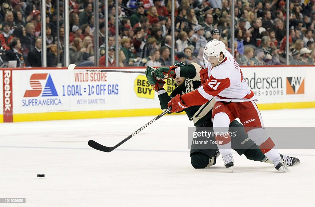 Tomas Tatar #21 of the Detroit Red Wings controls the puck against Nate Prosser #39 of the Minnesota Wild during the third period of the game on February 17, 2013 at Xcel Energy Center in St Paul, Minnesota. The Wild defeated the Red Wings 3-2.