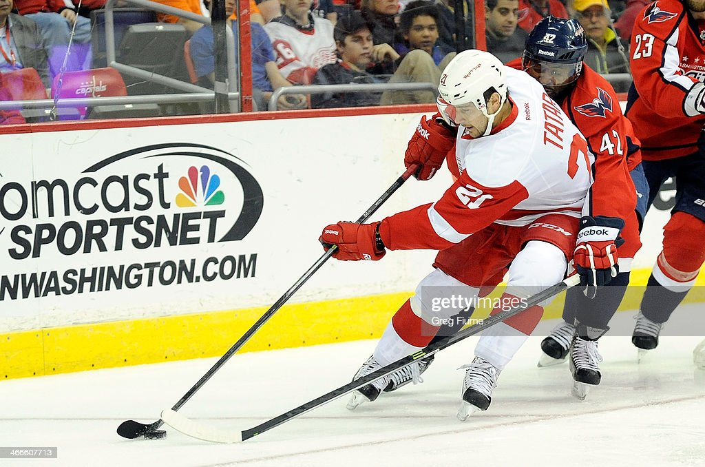 <a gi-track='captionPersonalityLinkClicked' href=/galleries/search?phrase=Tomas+Tatar&family=editorial&specificpeople=5652303 ng-click='$event.stopPropagation()'>Tomas Tatar</a> #21 of the Detroit Red Wings controls the puck in the second period against Joel Ward #42 of the Washington Capitals at Verizon Center on February 2, 2014 in Washington, DC.