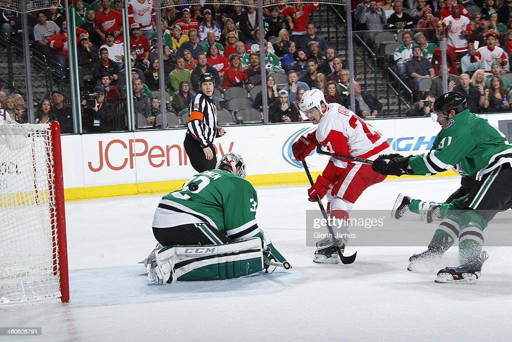 <a gi-track='captionPersonalityLinkClicked' href=/galleries/search?phrase=Tomas+Tatar&family=editorial&specificpeople=5652303 ng-click='$event.stopPropagation()'>Tomas Tatar</a> #21 of the Detroit Red Wings flips a puck into the net against <a gi-track='captionPersonalityLinkClicked' href=/galleries/search?phrase=Kari+Lehtonen&family=editorial&specificpeople=211612 ng-click='$event.stopPropagation()'>Kari Lehtonen</a> #32 of the Dallas Stars at the American Airlines Center on January 4, 2014 in Dallas, Texas.