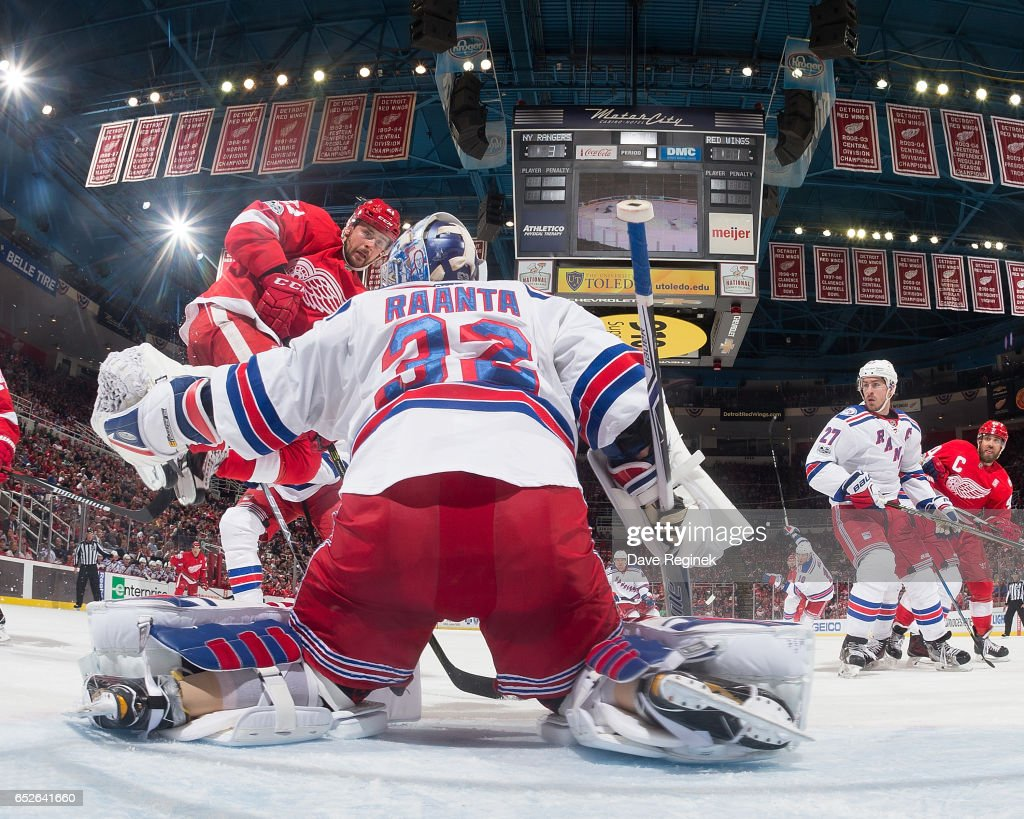 Tomas Tatar #21 of the Detroit Red Wings jumps to get out of the way of a shot as goalie Antti Raanta #32 of the New York Rangers drops down to make a save during an NHL game at Joe Louis Arena on March 12, 2017 in Detroit, Michigan. The Rangers defeated the Wings 4-1.