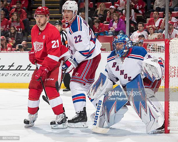 Tomas Tatar of the Detroit Red Wings looks for a pass in front of Nick Holden and goaltender Henrik Lundqvist of the New York Rangers during an NHL...