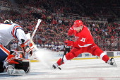 Tomas Tatar of the Detroit Red Wings makes a move with the puck and beats Viktor Fasth of the Edmonton Oilers in a shootout to clinch the win during...