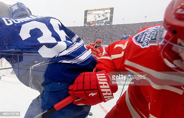 Tomas Tatar of the Detroit Red Wings pursues the puck against David Clarkson of the Toronto Maple Leafs in the second period during the 2014...
