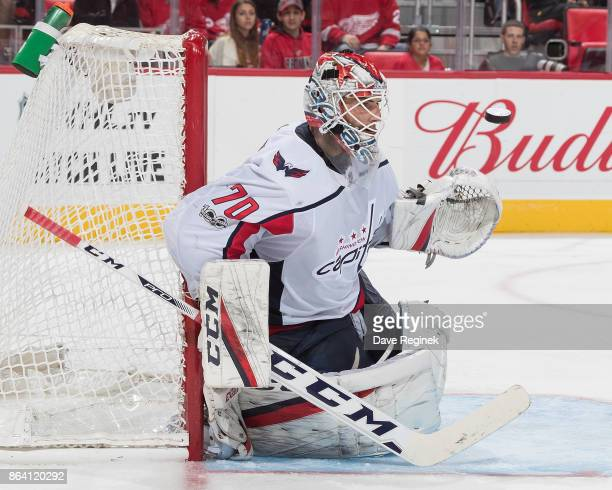 Tomas Tatar of the Detroit Red Wings scores a goal over the shoulder of goaltender Braden Holtby of the Washington Capitals during the third period...