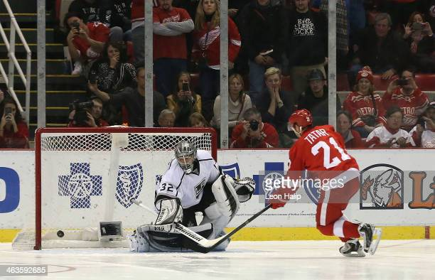 Tomas Tatar of the Detroit Red Wings scores against Jonathan Quick of the Los Angeles Kings during the shootout at Joe Louis Arena on January 18 2014...