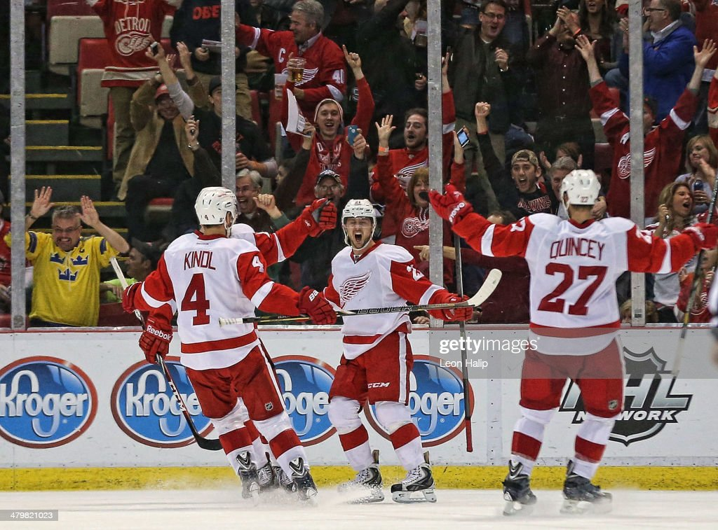 <a gi-track='captionPersonalityLinkClicked' href=/galleries/search?phrase=Tomas+Tatar&family=editorial&specificpeople=5652303 ng-click='$event.stopPropagation()'>Tomas Tatar</a> #21 of the Detroit Red Wings scores in the third period and celebrates with his teammates <a gi-track='captionPersonalityLinkClicked' href=/galleries/search?phrase=Jakub+Kindl&family=editorial&specificpeople=716743 ng-click='$event.stopPropagation()'>Jakub Kindl</a> #4 and <a gi-track='captionPersonalityLinkClicked' href=/galleries/search?phrase=Kyle+Quincey&family=editorial&specificpeople=2234340 ng-click='$event.stopPropagation()'>Kyle Quincey</a> #27 during the game against the Pittsburgh Penguins at Joe Louis Arena on March 20, 2014 in Detroit, Michigan. The Red Wings defeated the Penguins 5-4 in overtime.
