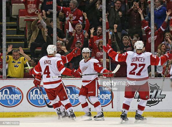 Tomas Tatar of the Detroit Red Wings scores in the third period and celebrates with his teammates Jakub Kindl and Kyle Quincey during the game...