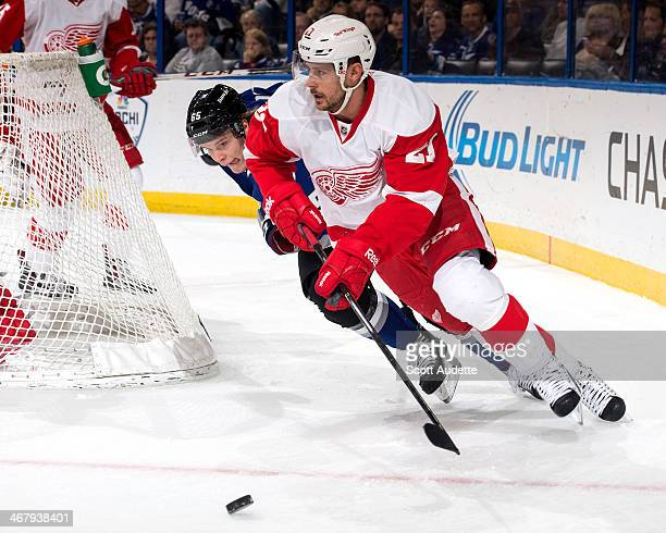 Tomas Tatar of the Detroit Red Wings skates with the puck against Vladislav Namestnikov of the Tampa Bay Lightning during the first period at the...