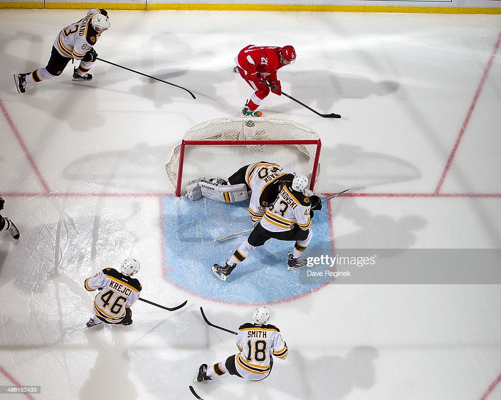 Tomas Tatar #21 of the Detroit Red Wings skates with the puck as goalie Tuukka Rask #40 of the Boston Bruins covers the net and teammates Brad Marchand #63, Matt Bartkowski #43, David Krejci #46 and Reilly Smith #18 all close in on him during Game Three of the First Round of the 2014 Stanley Cup Playoffs on April 22, 2014 at Joe Louis Arena in Detroit, Michigan.