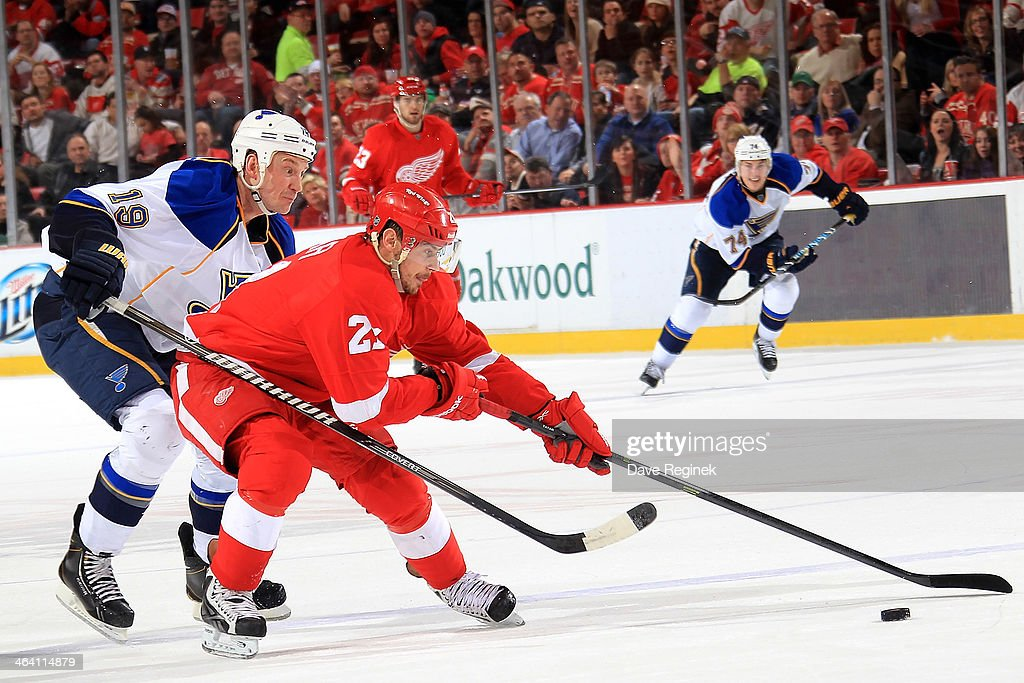 <a gi-track='captionPersonalityLinkClicked' href=/galleries/search?phrase=Tomas+Tatar&family=editorial&specificpeople=5652303 ng-click='$event.stopPropagation()'>Tomas Tatar</a> #21 of the Detroit Red Wings skates with the puck as <a gi-track='captionPersonalityLinkClicked' href=/galleries/search?phrase=Jay+Bouwmeester&family=editorial&specificpeople=201875 ng-click='$event.stopPropagation()'>Jay Bouwmeester</a> #19 of the St. Louis Blues reaches around him during an NHL game on January 20, 2014 at Joe Louis Arena in Detroit, Michigan.