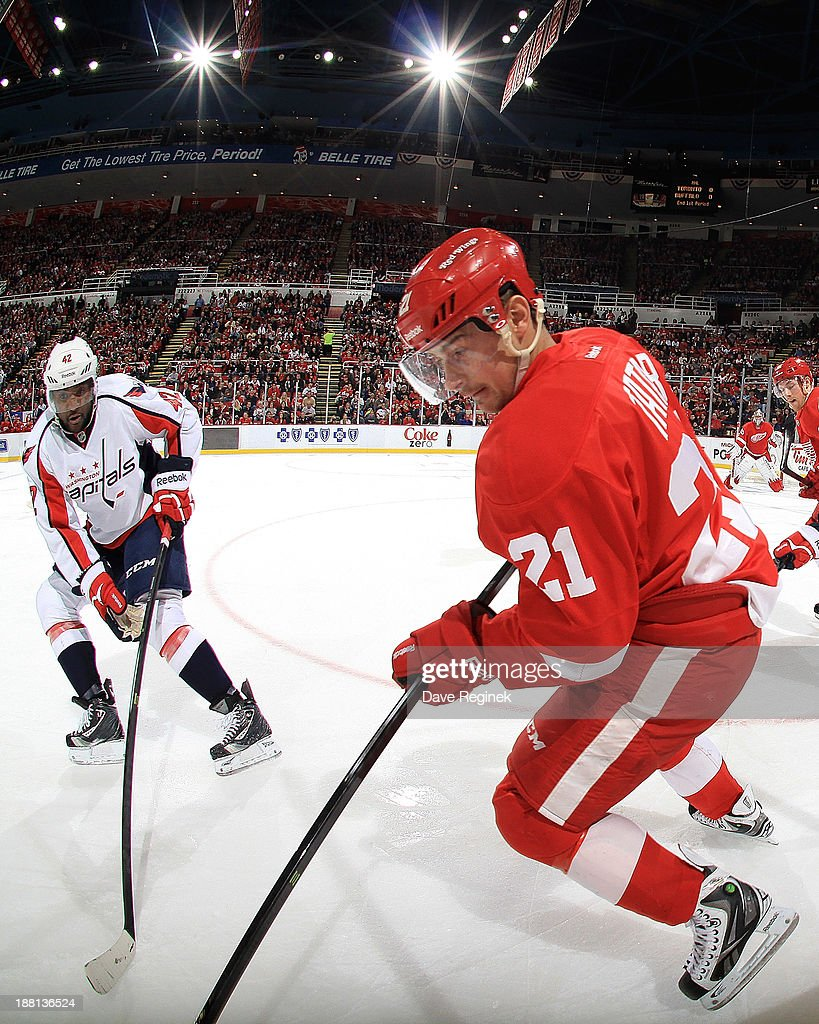 <a gi-track='captionPersonalityLinkClicked' href=/galleries/search?phrase=Tomas+Tatar&family=editorial&specificpeople=5652303 ng-click='$event.stopPropagation()'>Tomas Tatar</a> #21 of the Detroit Red Wings skates with the puck as Joel Ward #42 of the Washington Capitals tries to poke it away during an NHL game at Joe Louis Arena on November 15, 2013 in Detroit, Michigan.