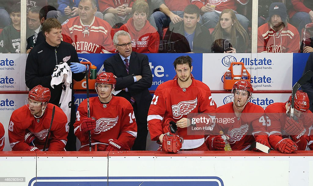 <a gi-track='captionPersonalityLinkClicked' href=/galleries/search?phrase=Tomas+Tatar&family=editorial&specificpeople=5652303 ng-click='$event.stopPropagation()'>Tomas Tatar</a> #21 of the Detroit Red Wings stands on the bench after getting hit with a high stick during the third period of the game against the Florida Panthers at Joe Louis Arena on January 26, 2014 in Detroit, Michigan. The Panthers defeted the Wings 5-4 in a shootout.