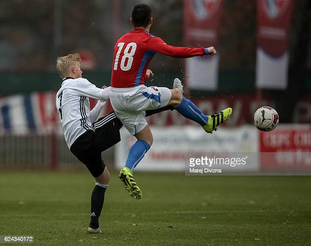 Tomas Vincour of Czech Republic battles for the ball with Per Lockl of Germany during the international friendly match between U16 Czech Republic and...