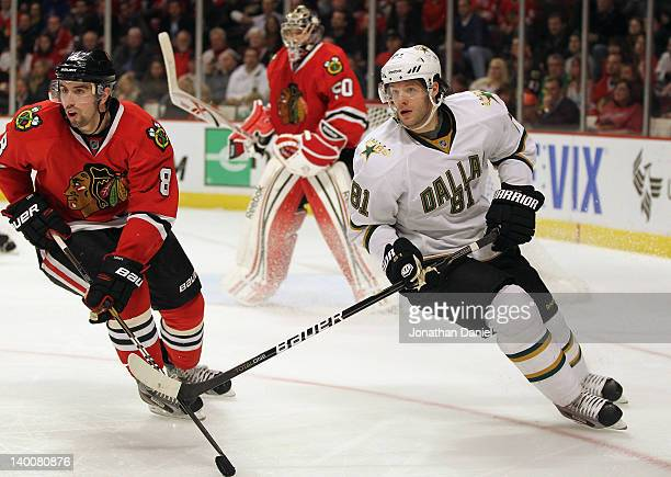 Tomas Vincour of the Dallas Stars and Nick Leddy of the Chicago Blackhawks turn to the puck at the United Center on February 23 2012 in Chicago...