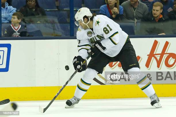 Tomas Vincour of the Dallas Stars attempts to control a loose puck during the game against the Columbus Blue Jackets on January 28 2013 at Nationwide...