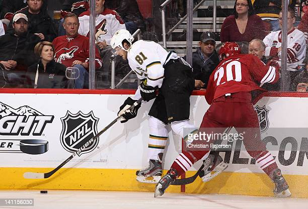 Tomas Vincour of the Dallas Stars controls the puck under pressure from Chris Summers of the Phoenix Coyotes during the NHL game at Jobingcom Arena...