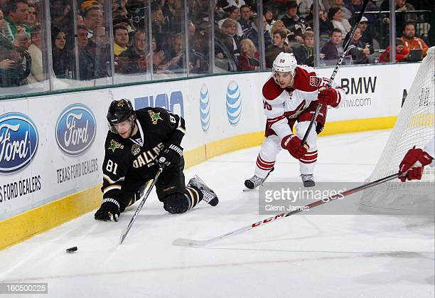 Tomas Vincour of the Dallas Stars goes to the ice chasing the puck against Antoine Vermette of the Phoenix Coyotes at the American Airlines Center on...