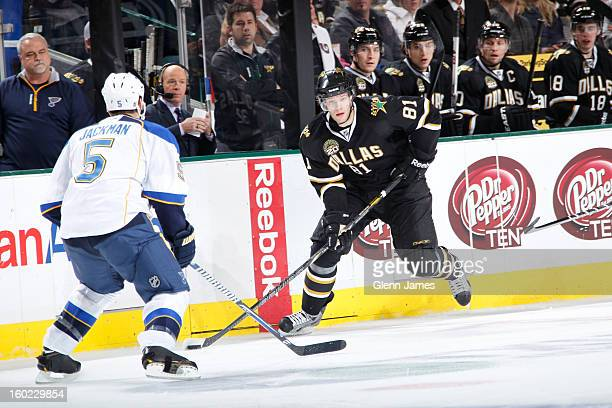 Tomas Vincour of the Dallas Stars handles the puck against Barret Jackman of the St Louis Blues at the American Airlines Center on January 26 2013 in...
