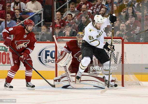 Tomas Vincour of the Dallas Stars tries to redirect a shot past goalie Mike Smith of the Phoenix Coyotes as defenseman David Schlemko looks to clear...