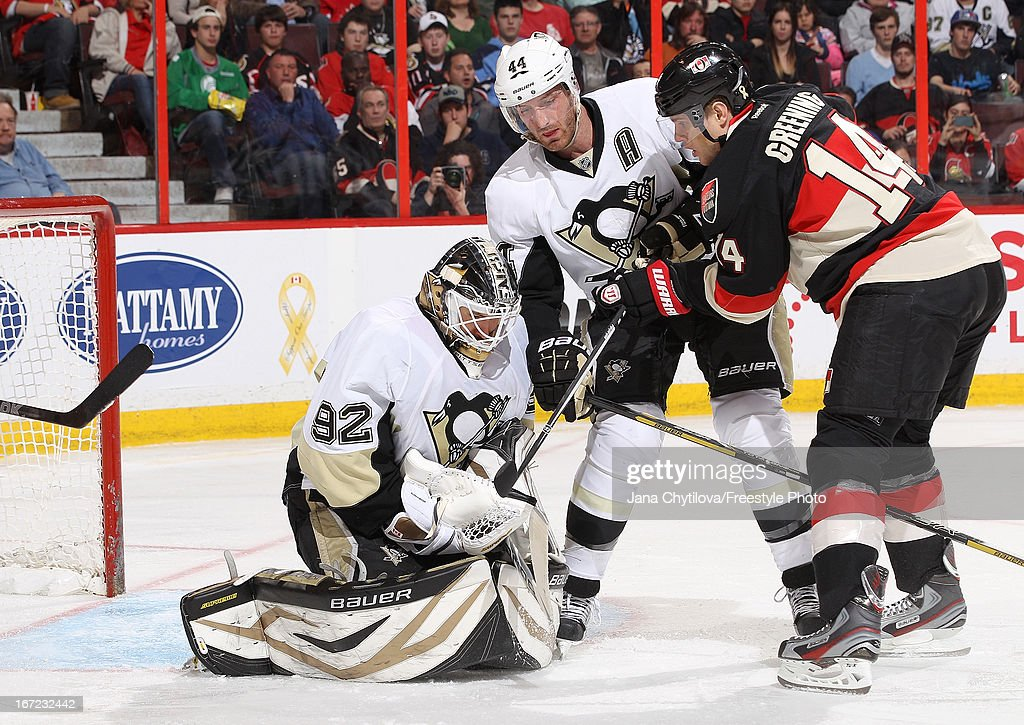 Tomas Vokoun #92 and Brooks Orpik #44 of the Pittsburgh Penguins guard against Colin Greening #14 of the Ottawa Senators during an NHL game at Scotiabank Place, on April 22, 2013 in Ottawa, Ontario, Canada.