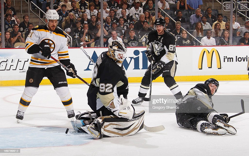 <a gi-track='captionPersonalityLinkClicked' href=/galleries/search?phrase=Tomas+Vokoun&family=editorial&specificpeople=202179 ng-click='$event.stopPropagation()'>Tomas Vokoun</a> #92 of the Pittsburgh Penguins can't stop a shot by <a gi-track='captionPersonalityLinkClicked' href=/galleries/search?phrase=David+Krejci&family=editorial&specificpeople=722556 ng-click='$event.stopPropagation()'>David Krejci</a> #46 of the Boston Bruins in front of Paul Martin #7 in Game One of the Eastern Conference Final during the 2013 NHL Stanley Cup Playoffs at Consol Energy Center on June 1, 2013 in Pittsburgh, Pennsylvania.