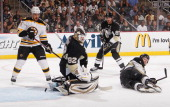 Tomas Vokoun of the Pittsburgh Penguins can't stop a shot by David Krejci of the Boston Bruins in front of Paul Martin in Game One of the Eastern...