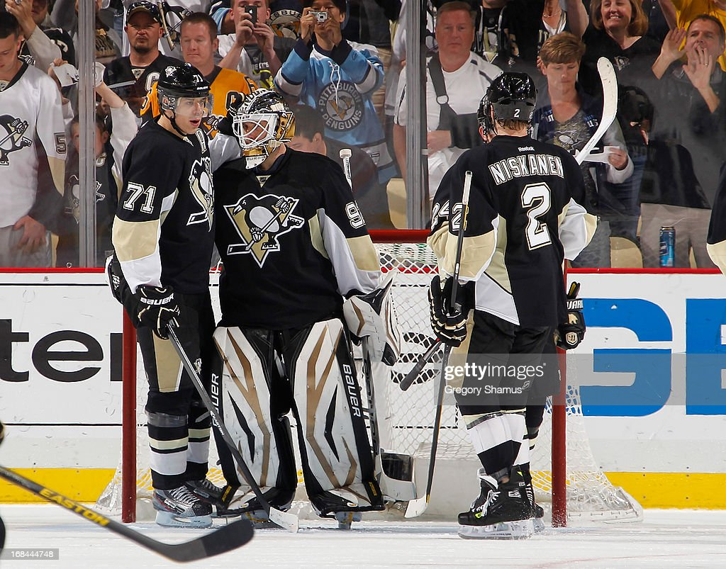 <a gi-track='captionPersonalityLinkClicked' href=/galleries/search?phrase=Tomas+Vokoun&family=editorial&specificpeople=202179 ng-click='$event.stopPropagation()'>Tomas Vokoun</a> #92 of the Pittsburgh Penguins celebrates with <a gi-track='captionPersonalityLinkClicked' href=/galleries/search?phrase=Evgeni+Malkin&family=editorial&specificpeople=221676 ng-click='$event.stopPropagation()'>Evgeni Malkin</a> #71 and <a gi-track='captionPersonalityLinkClicked' href=/galleries/search?phrase=Matt+Niskanen&family=editorial&specificpeople=2106633 ng-click='$event.stopPropagation()'>Matt Niskanen</a> #2 after a 4-0 win over the New York Islanders in Game Five of the Eastern Conference Quarterfinals during the 2013 NHL Stanley Cup Playoffs at Consol Energy Center on May 9, 2013 in Pittsburgh, Pennsylvania.