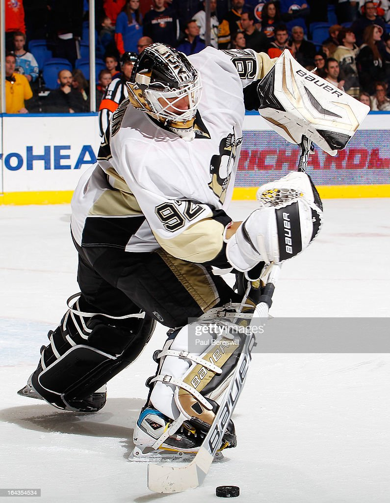 <a gi-track='captionPersonalityLinkClicked' href=/galleries/search?phrase=Tomas+Vokoun&family=editorial&specificpeople=202179 ng-click='$event.stopPropagation()'>Tomas Vokoun</a> #92 of the Pittsburgh Penguins clears the puck away from the New York Islanders in an NHL hockey game at Nassau Veterans Memorial Coliseum on March 22, 2013 in Uniondale, New York. The Penguins defeated the Islanders 4-2.