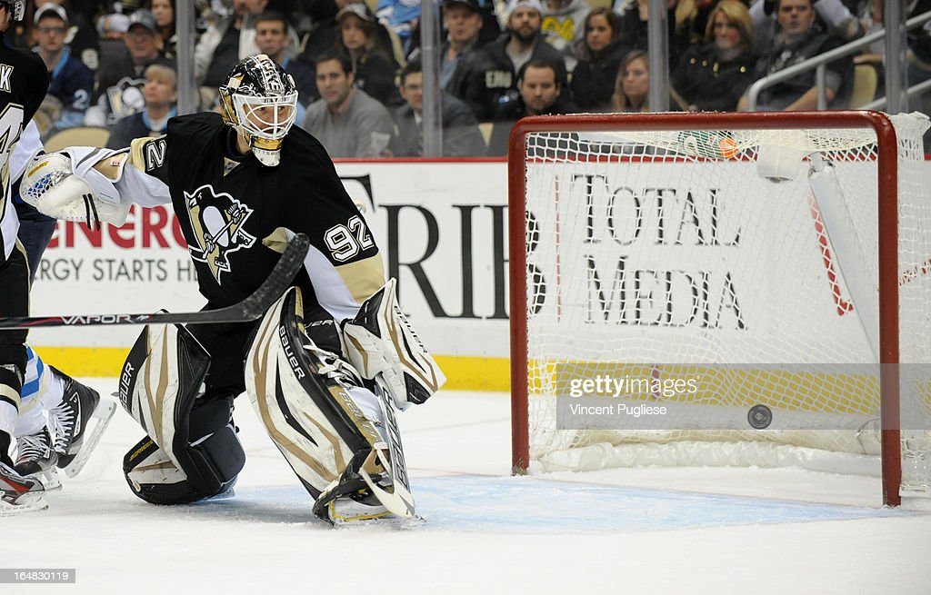 Tomas Vokoun #92 of the Pittsburgh Penguins deflects a shot during the second period against the Winnipeg Jets on February 28, 2013 at the CONSOL Energy Center in Pittsburgh, Pennsylvania.