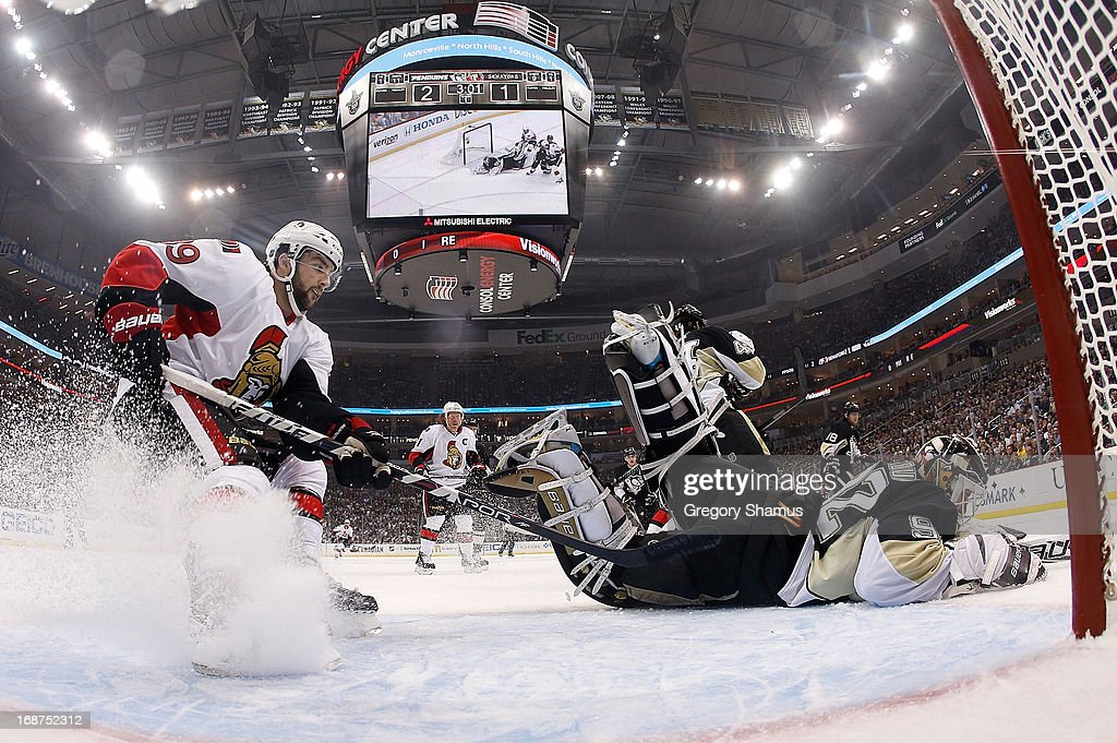 Tomas Vokoun #92 of the Pittsburgh Penguins makes a diving save in front of Cory Conacher #89 of the Ottawa Senators in Game One of the Eastern Conference Semifinals during the 2013 NHL Stanley Cup Playoffs at Consol Energy Center on May 14, 2013 in Pittsburgh, Pennsylvania.