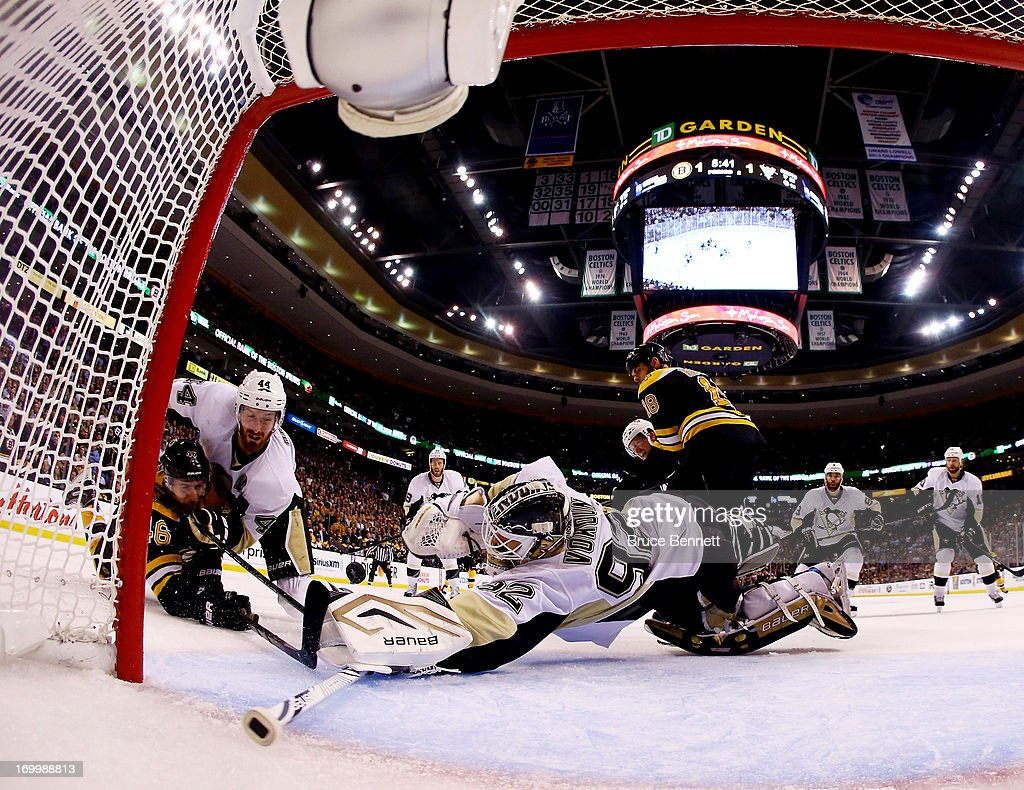 Tomas Vokoun of the Pittsburgh Penguins makes a save against David Krejci of the Boston Bruins as Brooks Orpik of the Pittsburgh Penguins defends...