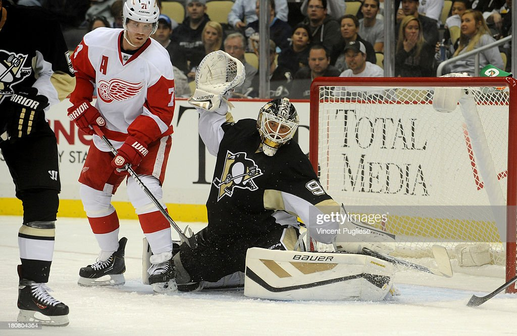 <a gi-track='captionPersonalityLinkClicked' href=/galleries/search?phrase=Tomas+Vokoun&family=editorial&specificpeople=202179 ng-click='$event.stopPropagation()'>Tomas Vokoun</a> # 92 of the Pittsburgh Penguins makes a save against the Detroit Red Wings during the second period of a preseason game on September 16, 2013 at the CONSOL Energy Center in Pittsburgh, Pennsylvania.