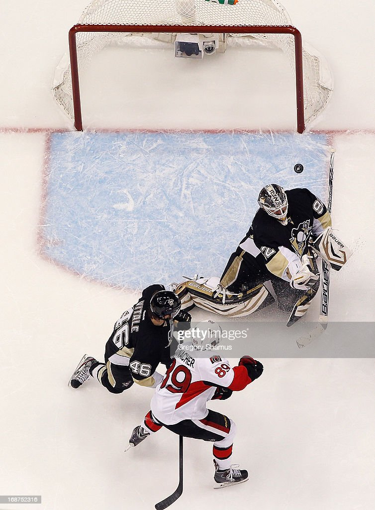 Tomas Vokoun #92 of the Pittsburgh Penguins makes a save in front of Joe Vitale #46 and Cory Conacher #89 of the Ottawa Senators in Game One of the Eastern Conference Semifinals during the 2013 NHL Stanley Cup Playoffs at Consol Energy Center on May 14, 2013 in Pittsburgh, Pennsylvania.