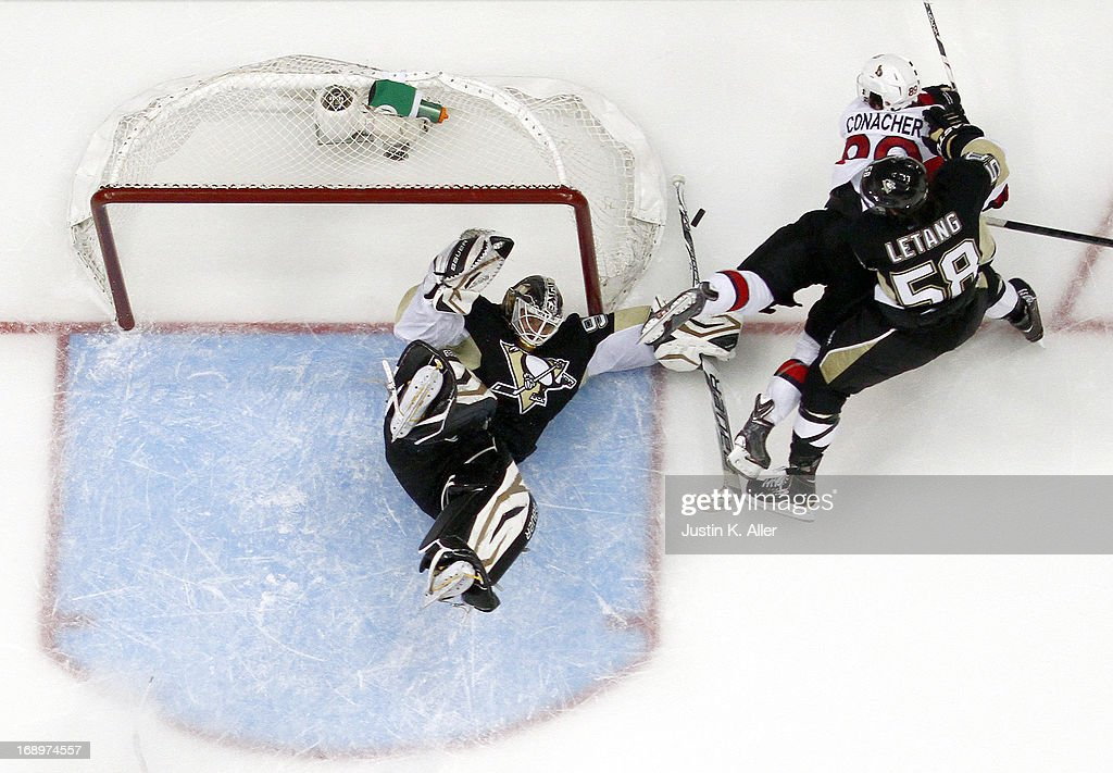 <a gi-track='captionPersonalityLinkClicked' href=/galleries/search?phrase=Tomas+Vokoun&family=editorial&specificpeople=202179 ng-click='$event.stopPropagation()'>Tomas Vokoun</a> #92 of the Pittsburgh Penguins makes a save on <a gi-track='captionPersonalityLinkClicked' href=/galleries/search?phrase=Cory+Conacher&family=editorial&specificpeople=8312407 ng-click='$event.stopPropagation()'>Cory Conacher</a> #89 of the Ottawa Senators in Game Two of the Eastern Conference Semifinals during the 2013 NHL Stanley Cup Playoffs at Consol Energy Center on May 17, 2013 in Pittsburgh, Pennsylvania. The Penguins defeated the Senators 4-3.