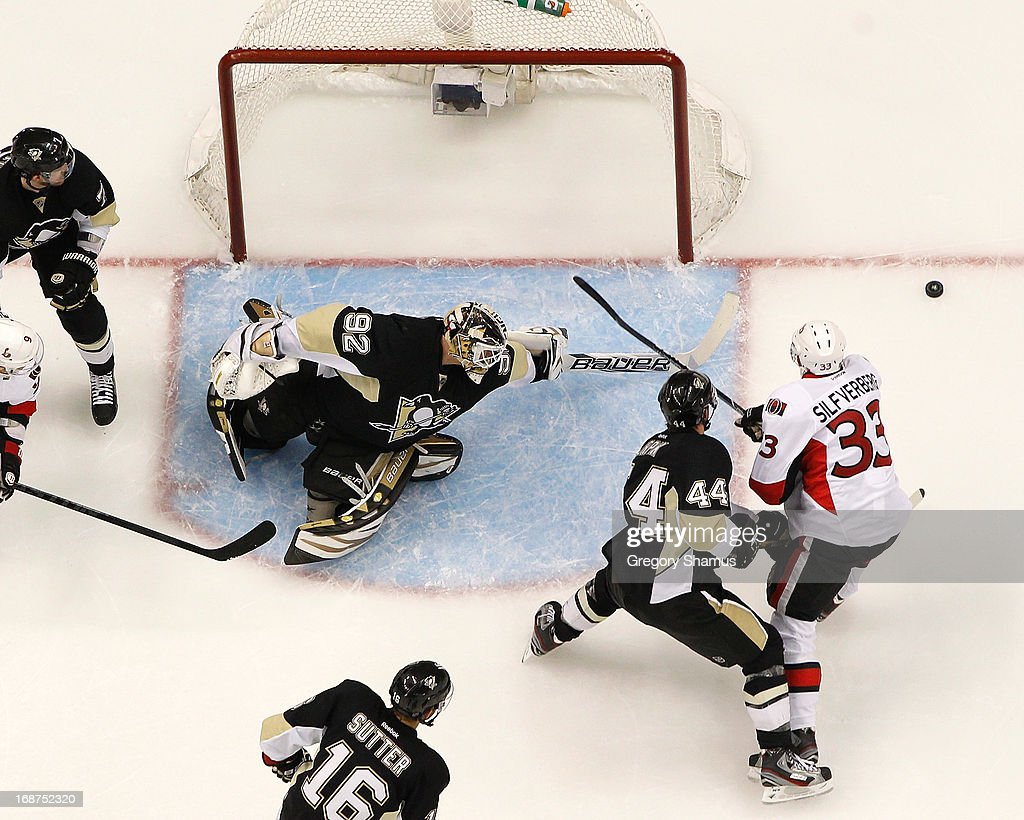 Tomas Vokoun #92 of the Pittsburgh Penguins reaches for the loose puck in front of Brooks Orpik #44 and Jakob Silfverberg #33 of the Ottawa Senators in Game One of the Eastern Conference Semifinals during the 2013 NHL Stanley Cup Playoffs at Consol Energy Center on May 14, 2013 in Pittsburgh, Pennsylvania.