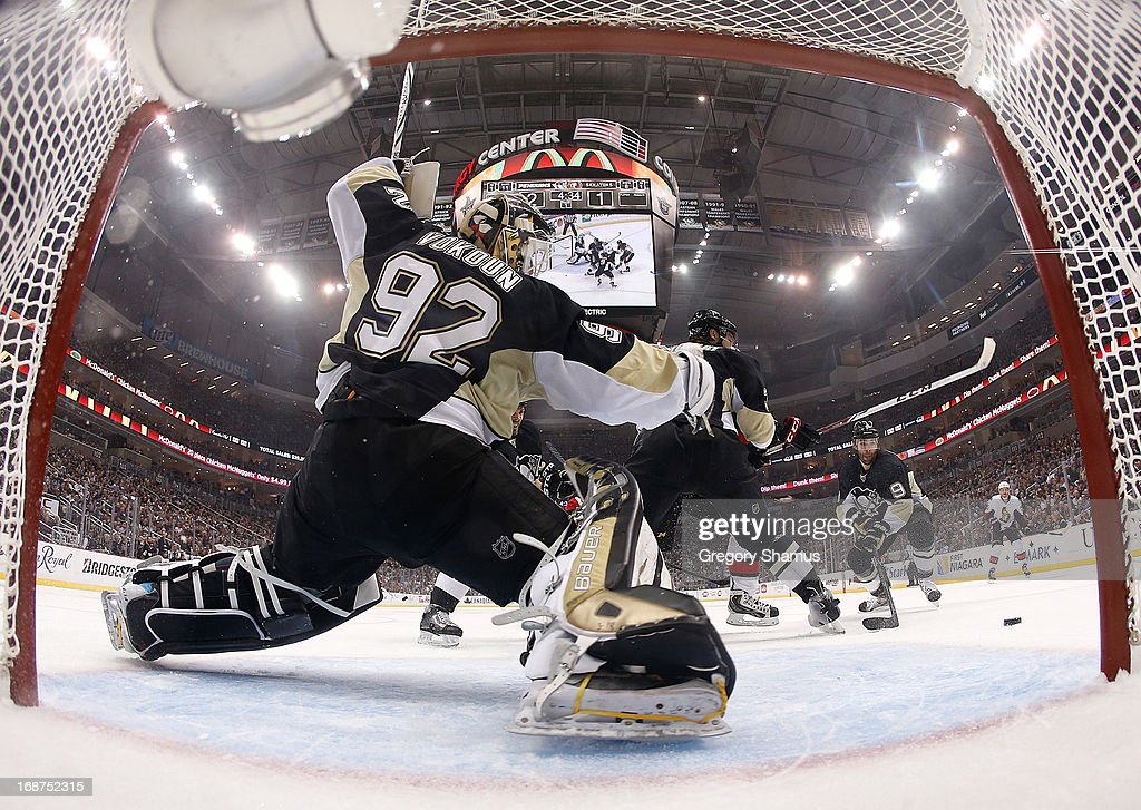 <a gi-track='captionPersonalityLinkClicked' href=/galleries/search?phrase=Tomas+Vokoun&family=editorial&specificpeople=202179 ng-click='$event.stopPropagation()'>Tomas Vokoun</a> #92 of the Pittsburgh Penguins watches the loose puck during the first period against the Ottawa Senators in Game One of the Eastern Conference Semifinals during the 2013 NHL Stanley Cup Playoffs at Consol Energy Center on May 14, 2013 in Pittsburgh, Pennsylvania.