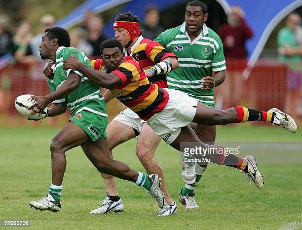 Tomasi Cama of Manawatu gets tackled during their match against Waikato on day two of the New Zealand National Sevens competition at Queenstown...