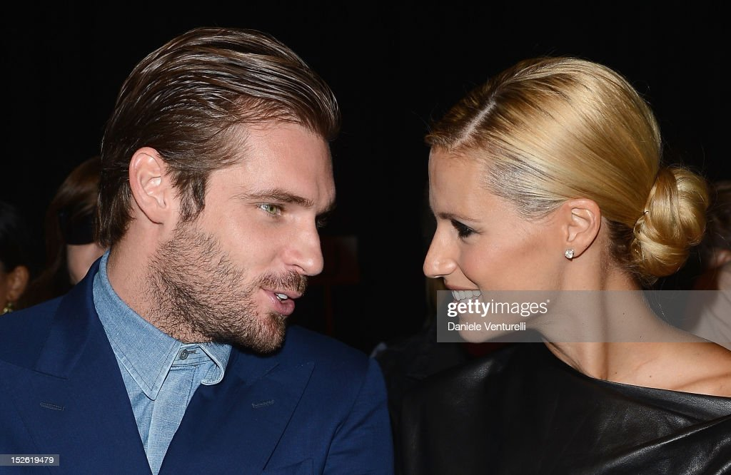 Tomaso Trussardi and Michelle Hunziker attend the Trussardi Spring/Summer 2013 fashion show as part of Milan Womenswear Fashion Week on September 23...