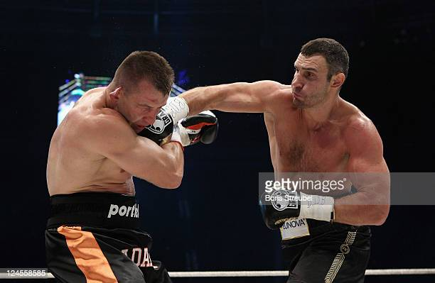 Tomasz Adamek of Poland and Vitali Klitschko of Ukraine exchange punches during the WBC Heavyweight World Championship fight between Vitali Klitschko...