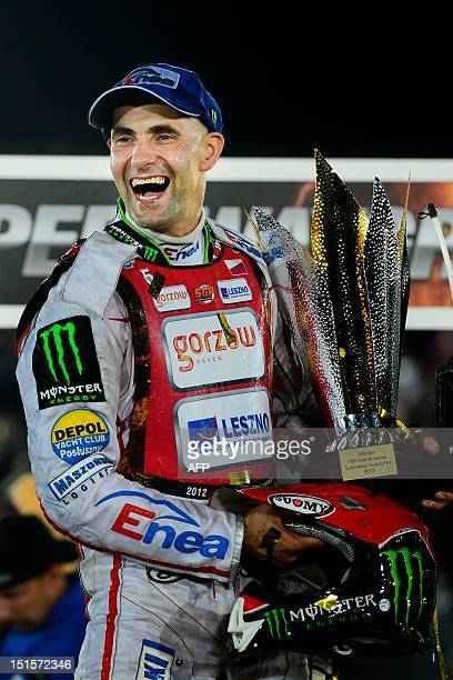 Tomasz Gollob of Poland holds the trophy as he celebrates on the podium on September 8 2012 after winning the FIM Scandinavian Speedway Grand Prix in...