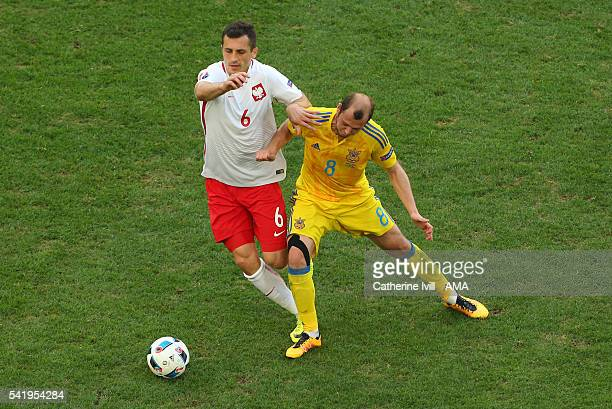 Tomasz Jodlowiec of Poland and Roman Zozulya of Ukraine during the UEFA EURO 2016 Group C match between Ukraine and Poland at Stade Velodrome on June...