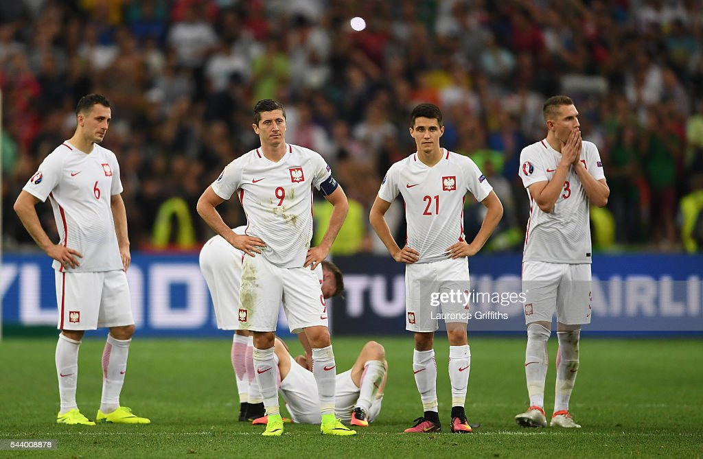 Tomasz Jodlowiec, Robert Lewandowski, Cedric Soares and Pepe of Portugal show their dejection after their defeat through the panelty shootout in the UEFA EURO 2016 quarter final match between Poland and Portugal at Stade Velodrome on June 30, 2016 in Marseille, France.