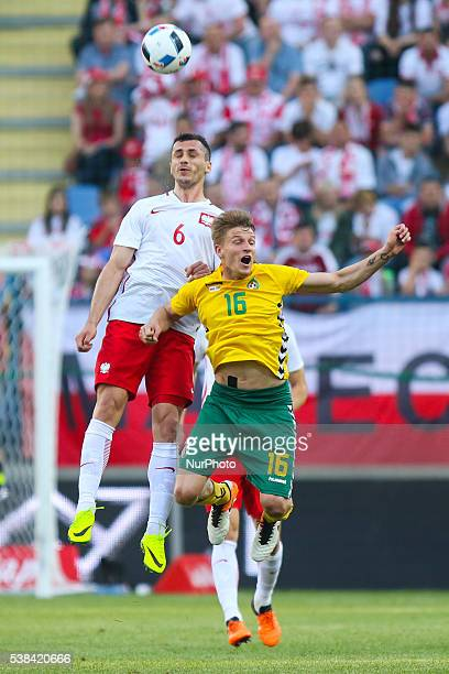 Tomasz Jodlowiec Vykintas Slivka during the Euro 2016 friendly football match between Poland and Lithuania on June 6 2016 in Krakow Poland