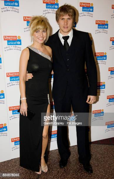 Tomasz Kuszczak and Guest arrive at Manchester United Football Club's 'United for UNICEF' gala dinner held at Old Trafford Manchester
