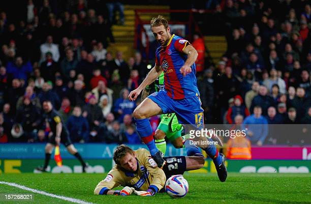 Tomasz Kuszczak of Brighton fouls Glenn Murray of Crystal Palace and concedes a penalty during the npower Championship match between Crystal Palace...