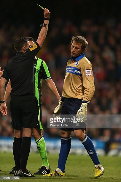 Tomasz Kuszczak of Brighton Hove Albion is shown a yellow card by Referee M Oliver during the npower Championship play off semi final first leg at...